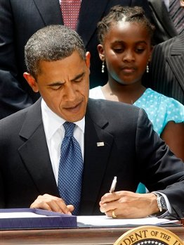Obama signs the bill